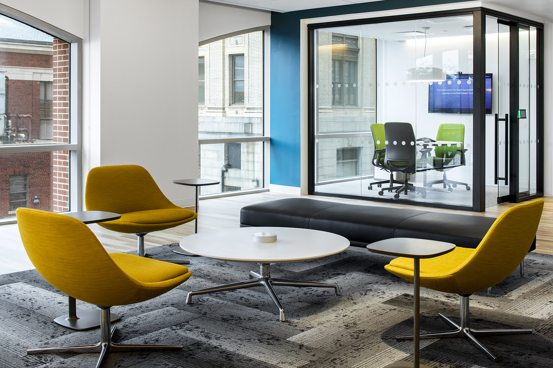 Wiley modern office with lounge seating and conference room with glass walls