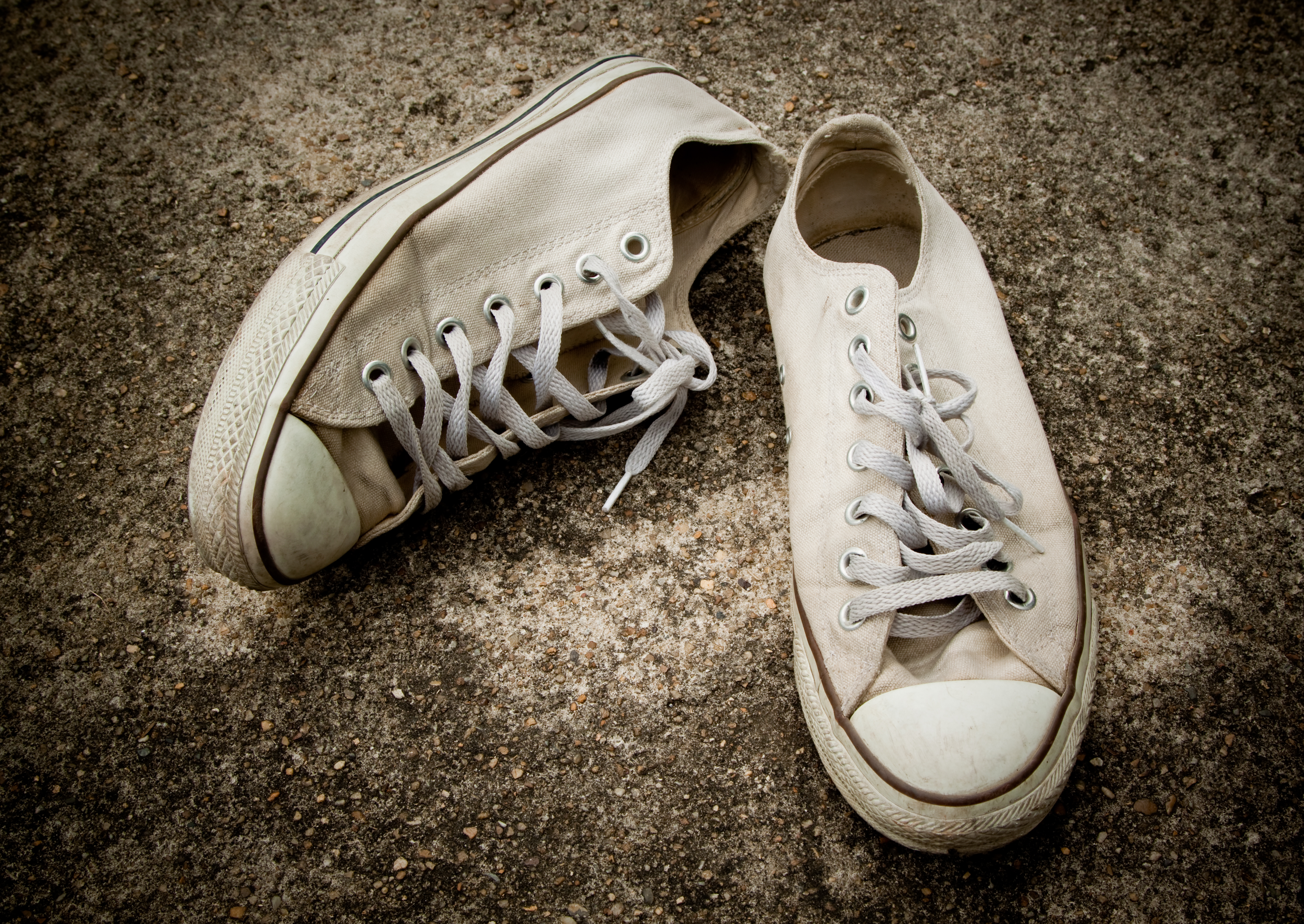 pair of older white converse sneakers