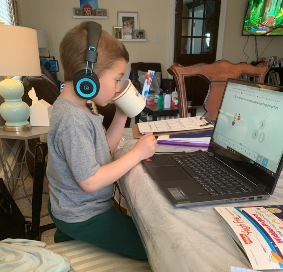 child-headphones-playing-game-laptop